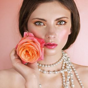 Ethereal makeup with peachy pink